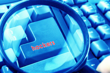 Magnifying glass on keyboard with Hackers word on button. Color halftone effect applied.