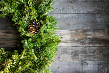 Christmas tree wreath on rustic wooden background