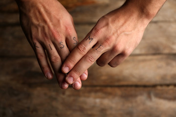Tattoo inscriptions on male fingers drawn with marker