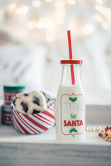 Milk for santa in a jar with christmas cookies
