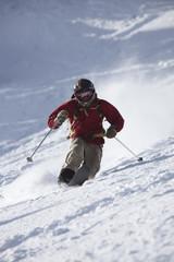 A male telemark skier rips turns in Bridger Bowl, Montana.