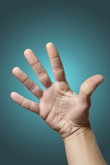 Open hand isolated on gradient blue background