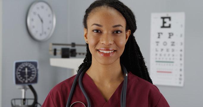 Black woman doctor smiling at camera