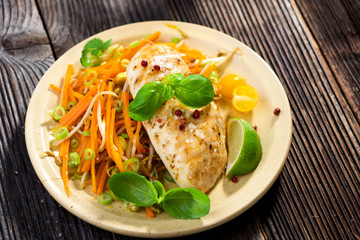 Roasted chicken breast with vegetable, basil and lime