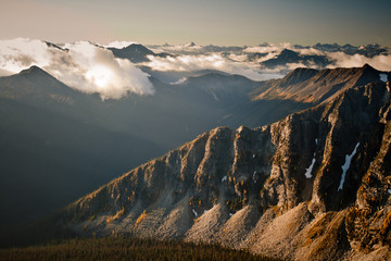 Early morning sunlight hits the rocky eastern ridgeline leading to Castle Mountain located in Washington, USA.