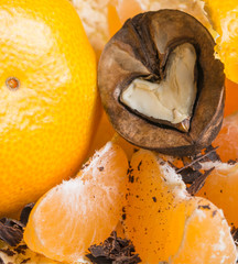 nuts in the shape of a heart with chocolate and citrus