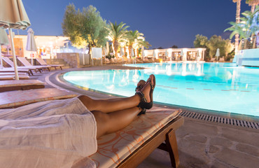 Relaxing at swimming pool