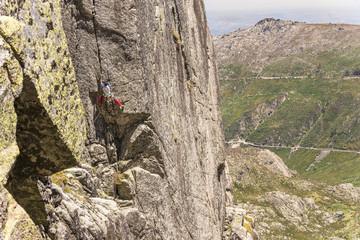 Climber getting into the funny part of the route, in Serra da Estrela, Portrugal.