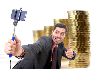 young attractive businessman in suit and tie taking selfie photo with money