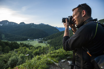 Photographer working at sunrise