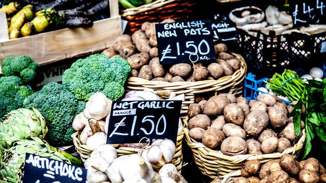 Fresh vegetables including potatoes for sale in London street market