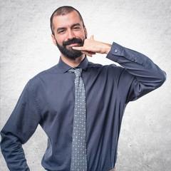 Man making phone gesture