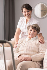 Disabled elderly woman and caregiver