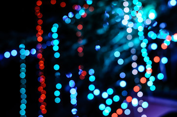 colorful night bokeh background in the city street