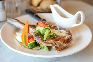 Pork chop steak and vegetable salad