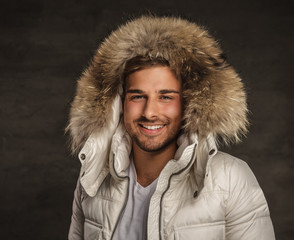 A man in winter jacket.