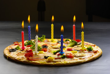 Pizza creative with candles