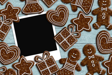 photos lying on wooden desk with gingerbread couple