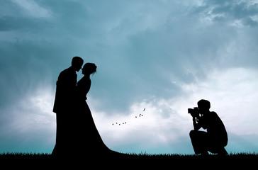 Wedding photographer service at sunset