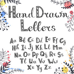 Vector hand drawn letters. English alphabet white on black. Doodle letters drawn on chalkboard.