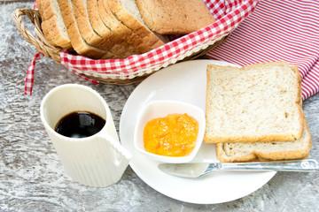 orange marmalade and bread for breakfast