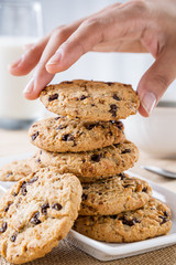 close up of hand taking cookie from stack