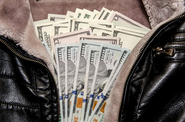 Dollars on black leather jacket
