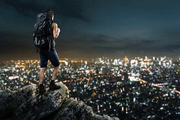 Man enjoys view on night city lights