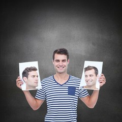 Composite image of man holding photos of his face