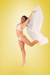 Beautiful brunette in white bikini holding towel