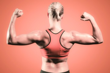 Composite image of muscular woman flexing her arms