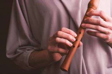 Flute in the woman hands horizontal