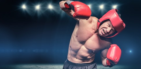 Composite image of aggressive boxer against black background