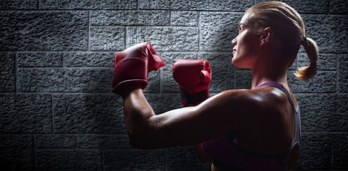 Composite image of side view of female boxer