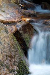 great wonders of nature - portrait of river waterfall with rocks, long exposure effect of softness