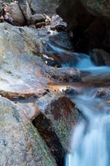 great wonders of nature - close-up of streaming brook waterfall in winter season