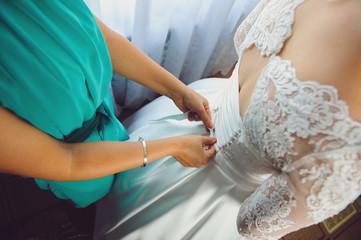 Bridesmaid Tying Dress