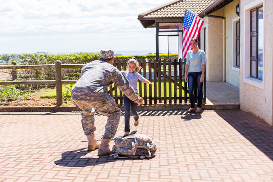 little girl running to her military father