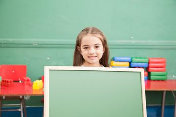 Girl Holding a blackboard