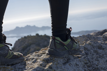 adrenaline running on a vertiginous peak with an amazing background