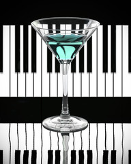Blue cocktail on a black and white piano background