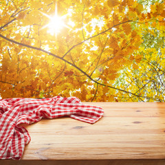 Empty table and tablecloth. Nature background outdoors.