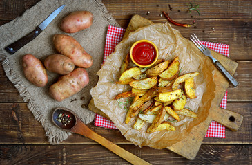 Potato wedges with a peel fries on parchment