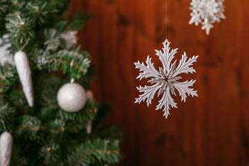 christmas tree with a white snowflake toy