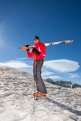 Young man wearing a pair of skis