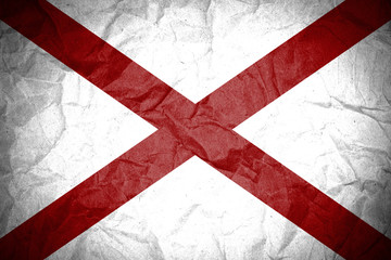 Grunge of Alabama flag on crumpled paper