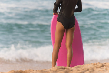 Female Surfer Stands Beach Watching Surf Waiting Pink Body Board