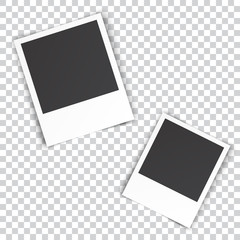 two blank photo pinned on white wall