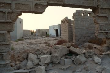 Traditional wall made of sand and coral, Old Ras Al Khaimah abandoned ghost town, Al Jazirah Al Hamra Wall mural
