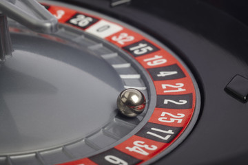 Casino roulette detail with ball in number twenty-five. Gambling